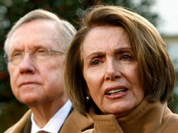 U.S. Speaker of the House Rep. Nancy Pelosi (D-CA) speaks to the media as Senate Majority Leader Sen. Harry Reid (D-NV) listens after a meeting with President Barack Obama, December 9, 2009 at the White House in Washington, D.C.