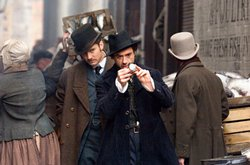 Robert Downey, Jr. and Jude Law as Holmes and Watson in