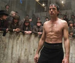 Robert Downey, Jr. as Sherlock Holmes in a boxing match from the new movie by director Guy Ritchie.