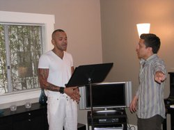 Christian Ellis sings scales during a lesson with his voice coach, Enrique To...