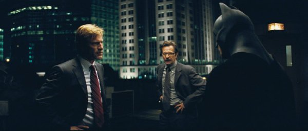 "Aaron Eckhart, Gary Oldman and Christian Bale in ""The Dark Knight"""