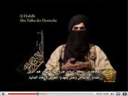 This video screenshot shows a young speaker of the Islam Terror Group Al Quaida in January 2009.
