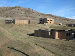 These buildings are part of a simulated Afghan village on Camp Pendleton. Rol...