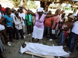 Roselyn Joseph cries over the body of her daughter who died because of the ea...