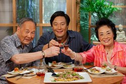 Chef Ming Tsai is joined by his parents, Iris and Stephen Tsai, who put the East-West ingredients to work with Tamari Pork and Bell Pepper on Olive Oil-Noodle Cake.