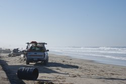 Lifeguards monitored beachgoers on the Mission Beach boardwalk on January 14,...