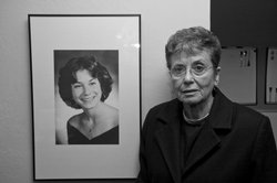 Harriet Salarno stands next to a photo of her daughter, Catina Rose, who was murdered in 1979.