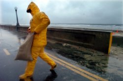 San Diego Lifeguard Mark Kortch places sandbags in front of the lifeguard sta...