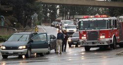 Emergency crews respond to a car accident on northbound College Avenue on Jan...