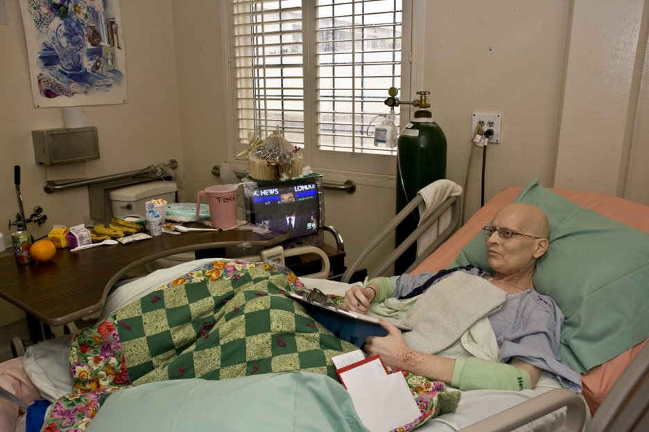 Inmate Brian Long is dying of prostate cancer and will likely spend his remaining days in the hospice unit, where  an attempt is made to humanize the rooms. Shutters are placed over barred windows, pictures hung on the walls, and a small, television set is made available. The quilt on his bed is one of many donated by Shepherd of The Hills Lutheran Church in Vacaville. These quilts are made by a group of elderly women for the inmates in hospice care.