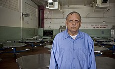Richard Lauranzano, 62, stands in the prison lunch room. He is serving a 50-y...