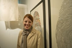 Me, standing in front of my thumbprint portraits created by Cheryl Sorg and c...