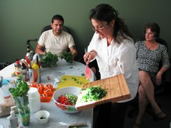 Chef Palma Bellinghieri chops fresh vegetables for a tabouli salad. She believes eating the right foods can help reduce chronic pain.