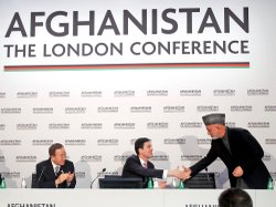 Afghan President Hamid Karzai (right) greets Britain's Foreign Minister David...