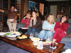 Parents at a house party sponsored by Planned Parenthood listen to a mother t...