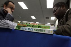 Job seekers have their resumes reviewed during a 'Boot Camp' for job seekers ...