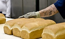 An inmate working in the bakery makes between $90 and $100 a month. It is a d...