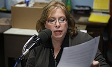 These Days host Maureen Cavanaugh reading her script while recording interviews inside the R.J. Donovan Correctional Facility, the only state-run prison in San Diego county.  KPBS' These Days is the first radio show to be recorded inside a California state prison.