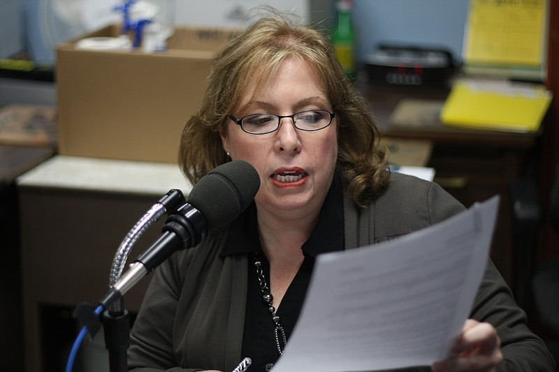 These Days host Maureen Cavanaugh reading her script while recording intervie...