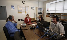 Host Maureen Cavanaugh, producer Pat Finn, and director Kurt Kohnen recording...