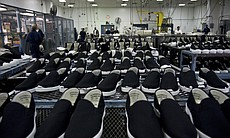 The shoe factory at the R.J. Donovan Correctional Facility employs approximately 75 inmates.  The factory makes roughly 2,000 shoes a day for all the inmates throughout the California state prison system.