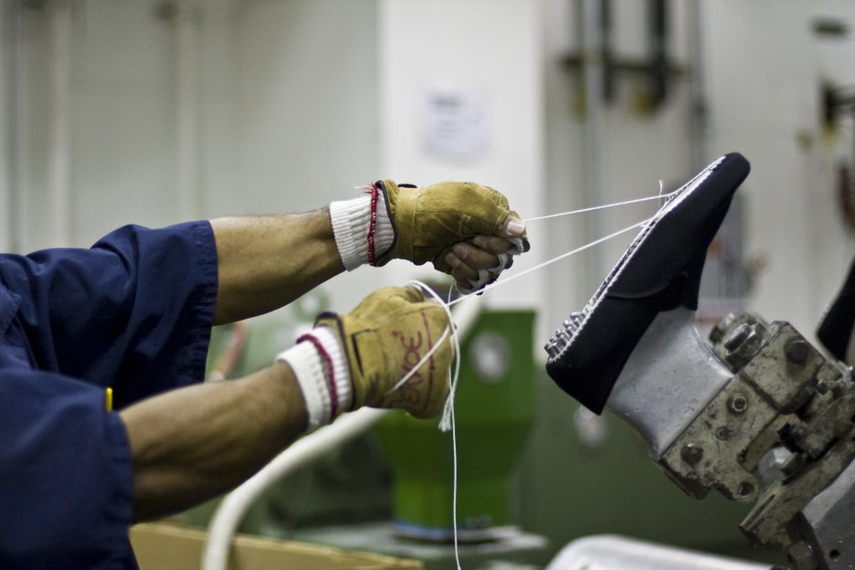 An inmates threads part of a shoe under construction.  Like the bakery jobs, shoe factory jobs are coveted because they pay between $90 and $100 a month.  Donovan used to have an eye glass factory that employed 115 inmates and made eyeglasses for MediCal patients.  It closed in October, 2009 but discussions are ongoing regarding its reopening.