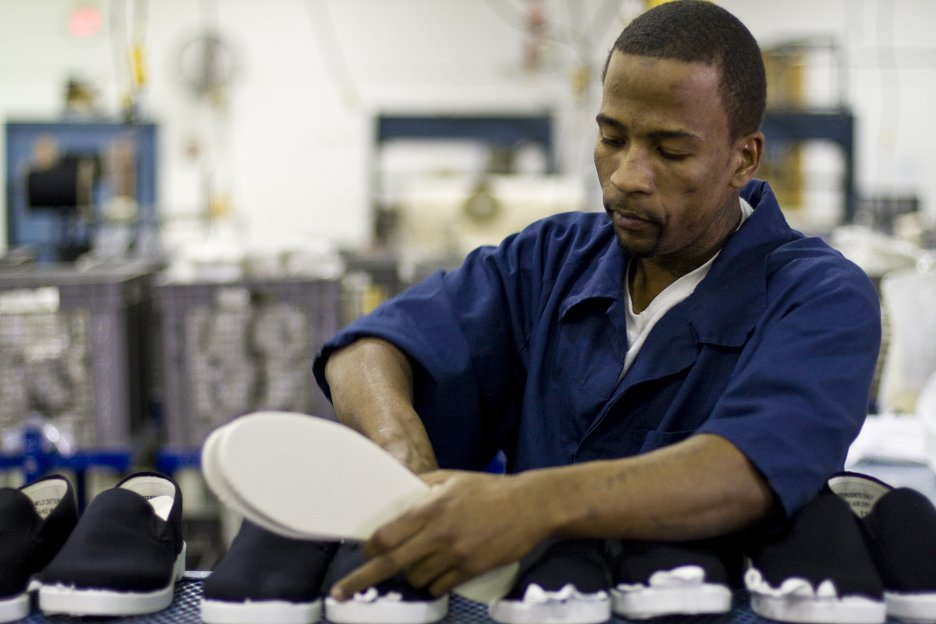 Inmate Kevin Robinson is serving a life sentence for torture.  He works in the shoe factory inserting soles into the shoes. The factory makes high top and low top versions of the shoes.
