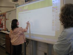 Students use a touch-screen whiteboard instead of the traditional chalkboard at Pershing Middle School in San Carlos.