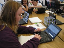 Every student in class is assigned their own Netbook to do assignments and classwork.