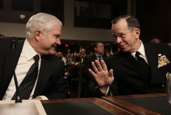 Defense Secretary Robert Gates (L) and Chairman of the Joint Chiefs of Staff Adm. Michael Mullen (R) participate in a Senate Armed Services Committee hearing for the budget of the Department of Defense and to review the 'Don't Ask, Don't Tell' policy on Capitol Hill on February 2, 2010 in Washington, DC.