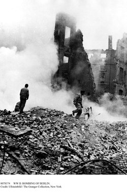 Ruins smolder in central Berlin after an Allied bombing raid. The Allied aerial bombardment of Germany during World War II resulted in more than half-a-million civilian casualties.