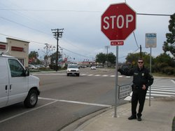 Chula Vista traffic officer Shon Thurman stands in front of one of the largest stop signs in San Diego County on January 26, 2010. Thurman has helped introduce a number of measures to make walking safer in Chula Vista.
