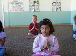 Students at the Integral School practice mediation and yoga during the regular school day.
