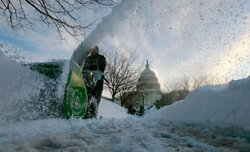 Capitol grounds worker Kevin Trodden uses a snow blower to clear side walks at the US Capitol on February 11, 2010 in Washington, DC. Washington was hit with a second snow storm in a week leaving a foot of snow and causing wide spread power outages.