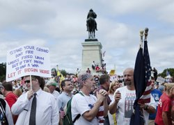 Protesters gather and hold signs during the Tea Party Express rally on Septem...