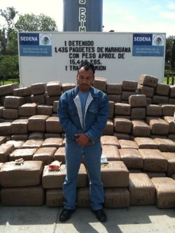 Mario Lopez Castro, 34, stands in front of the drugs he was allegedly caught ...