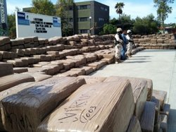 The Mexican Army displays 35,000 pounds of large bricks of marijuana, wrapped in brown packing tape, that they seized in Baja California on February 22, 2010.