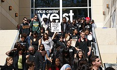Students walk out of the UCSD administration's teach-in on February 24, 2010. A majority of the students in attendance left the official teach-in, and gathered together outside of Price Center to have their own teach-in.