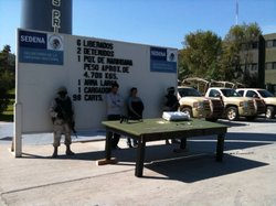 Two people who were allegedly holding six men captive are detained by the Mex...