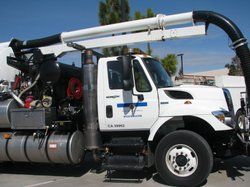 Trucks such as this one are used to clean sewer lines in San Diego. The truck was on display during a news conference on February 24, 2010.