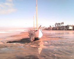 During overnight storm a sailboat washed up on South Mission Beach in San Die...