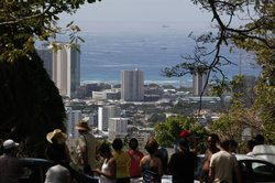 A crowd of people watch Oahu's southern shore in anticipation of a possible tsunami along Tantalus Drive in Honolulu, Hawaii on February 27, 2010 in Honolulu, Hawaii.