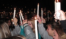Mourners hold up candles in memory of 17-year-old Chelsea King during a vigil at St. Michael's Catholic Church in Poway on March 2, 2010.