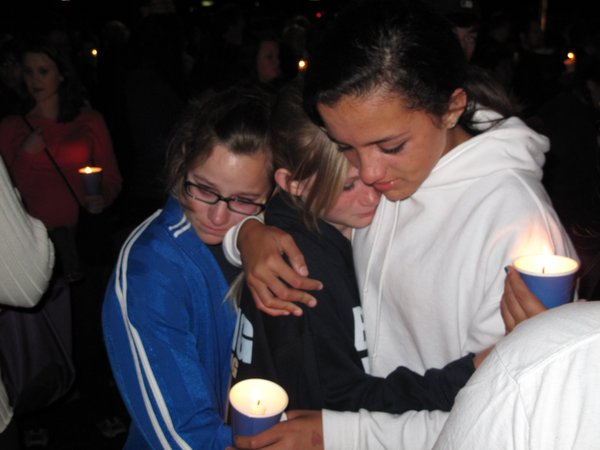 Friends of Chelsea King grieve over the loss of their friend at a candlelight vigil at St. Michael's Catholic Church in Poway on March 2, 2010.