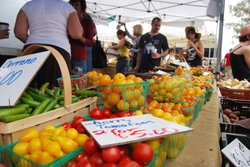 Brightly colored fruits and vegetables sit on display at the Hillcrest Farmer...