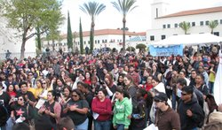 Several hundred San Diego State University students come together on March 4,...