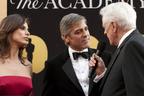 George Clooney seemed to be schmoozing everywhere as if he were running for office and he had the election all wrapped up.