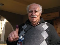 Iraqi expatriate Tinue Shad displays his inked finger after casting his vote ...