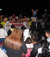 Following the vigil, dozens of people walked to the front of the Escondido High School to pay tribute to Amber Dubois at a make-shift memorial, March 8, 2010.