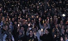 More than 1,000 people gathered for a candlelight vigil at Escondido High Sch...